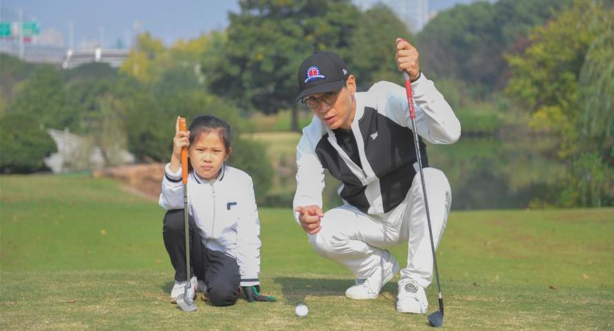 體育圖片故事|金緒晉:我在中國執教高爾夫